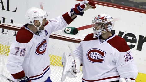 Montreal Canadiens' Hal Gill (75) congratulates goalie Carey Price (31) after their 3-0 win over the Pittsburgh Penguins in a NHL hockey game, Saturday, March 12, 2011, in Pittsburgh. (AP Photo/Keith Srakocic)