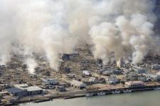 White smokes rises from burning houses in Yamadamachi in Iwate Prefecture, northern Japan, Saturday, March 12, 2011. (Kenji Shimizu / The Yomiuri Shimbun)