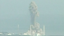 A hydrogen explosion at the Fukushima power plant in Japan is seen on Monday, March 14, 2011, in this video image.