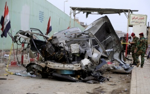 Security forces personnel inspect the scene of a car bomb attack in the Husseiniyah suburb of northeastern Baghdad, Iraq, Monday, May 6, 2013. (AP / Karim Kadim)