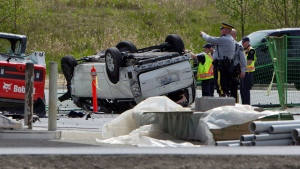 Police investigate the aftermath of a fatal car crash at the intersection of 176th Street and 32nd Avenue in Surrey, B.C. on Sunday, April 28, 2013. RCMP in British Columbia say five people are dead after a serious crash near the U.S border. (Eric Dreger / THE CANADIAN PRESS)