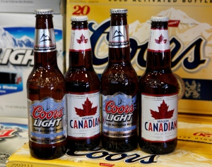 Coors Light and Molson Canadian bottles of beer are displayed in Denver in this November 2010 file photo. (AP Photo/Ed Andrieski)