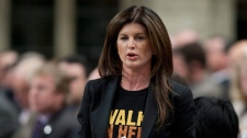 Minister of Public Works and Government Services and Minister for the Status of Women Rona Ambrose rises during Question Period in the House of Commons on Parliament Hill in Ottawa, Tuesday March 8, 2011. (Adrian Wyld / THE CANADIAN PRESS)