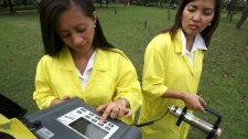 Filipino scientists at the Philippine Nuclear Research Institute use a SAM portable Gamma Spectrometer to measure the gamma radiation levels in the atmosphere at their facility in suburban Quezon city northeast of Manila, Philippines Monday, March 14, 2011. The Government increased the frequency of monitoring radiation levels to four times daily from the routine once-a-week Monday following the threat of multiple nuclear reactor meltdowns at the quake and tsunami-savaged northeastern coast of Japan where fears spread over possible radioactive contamination. (AP / Bullit Marquez)