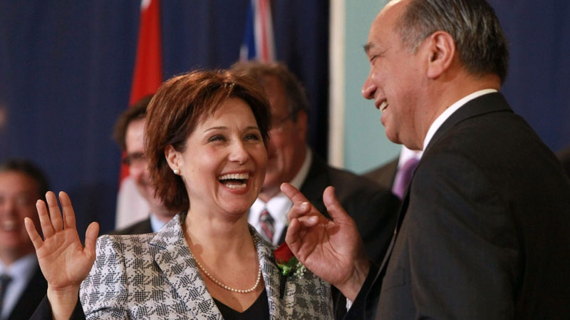 British Columbia Premier Christy Clark, left, laughs with Lt.-Gov. Steven Point after she mixed up her words while being sworn-in at Government House in Victoria, B.C., on Monday March 14, 2011. (Darryl Dyck / THE CANADIAN PRESS)