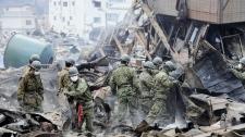 Japan Self-Defense Force's members conduct search operation in Otsuchi, Iwate, northern Japan Tuesday, March 15, 2011 following Friday's massive earthquake and the ensuing tsunami. (AP / Yomiuri Shimbun, Yoichi Hayashi)