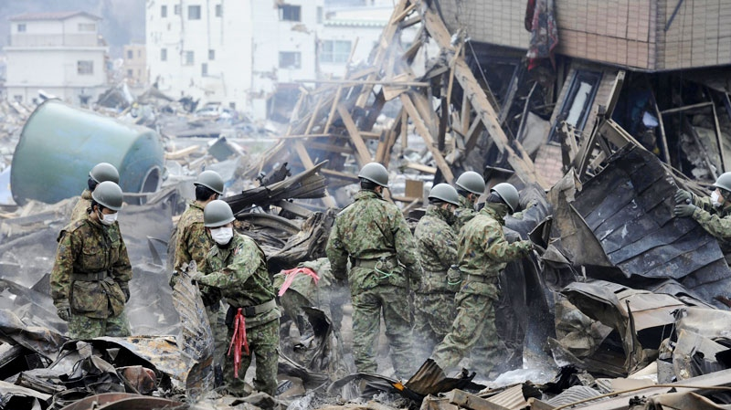 Japan Self-Defense Force's members conduct search operation in Otsuchi, Iwate, northern Japan Tuesday, March 15, 2011 following Friday's massive earthquake and the ensuing tsunami. (AP / Yomiuri Shimbun, Yoichi Hayashi)