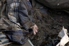 A hand of a victim is seen in the debris in Saito village, Miyagi Prefecture, Monday, March 14, 2011 after Japan's biggest recorded earthquake slammed into its eastern coast Friday. (AP / Shuji Kajiyama)