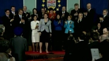 B.C. Premier Christy Clark stands in front of her new cabinet. March 14, 2011. (CTV)