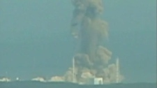 Smoke ascends from the Fukushima Dai-ichi nuclear plant's Unit 3 in Okumamachi, Fukushima Prefecture, northern Japan, Monday, March 14, 2011.