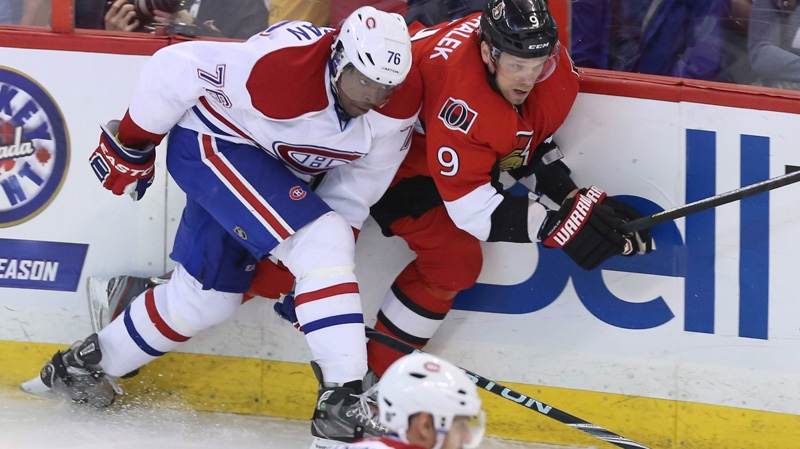 Ottawa Senators' Milan Michalek (9) is checked by Montreal Canadiens' P.K. Subban (76) during the first period of game four of the first round of Stanley Cup hockey action on Tuesday May 7, 2013 in Ottawa . THE CANADIAN PRESS/Fred Chartrand