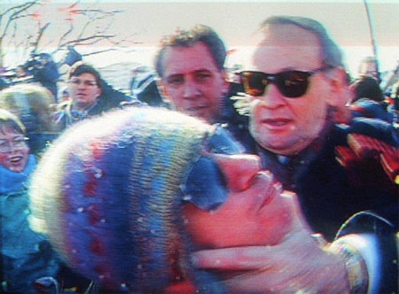 This file television frame-grab shows then Prime Minister Jean Chretien confronting Bill Clennett during flag day, Feb. 15, 1996 in Hull (now Gatineau), Que. Social activist Clennett, who once tussled with Jean Chretien, is now trying to wrestle votes away from Premier Jean Charest. (CP / Global News, Phil Nolan)