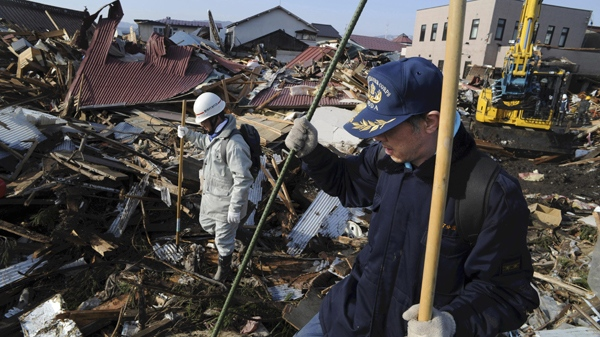 Local firefighting volunteers seek survivors at the devastated Noda village, northern Japan, Monday, March 14, 2011. (AP / The Yomiuri Shimbun, Yoichi Hayashi)