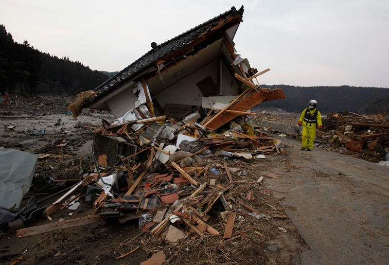 A firefighter examines the damage of a house in Saito, Miyagi Prefecture, Monday, March 14, 2011 after Japan's biggest recorded earthquake slammed into its eastern coast Friday. (AP / Shuji Kajiyama)