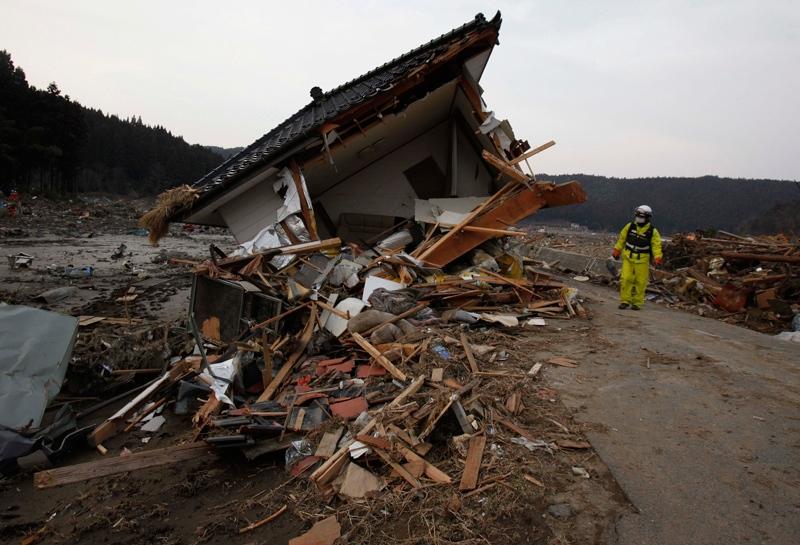 A firefighter examines the damage of a house in Saito, Miyagi Prefecture, Monday, March 14, 2011 after Japan's biggest recorded earthquake slammed into its eastern coast Friday. (AP / Shuji Kajiyama)