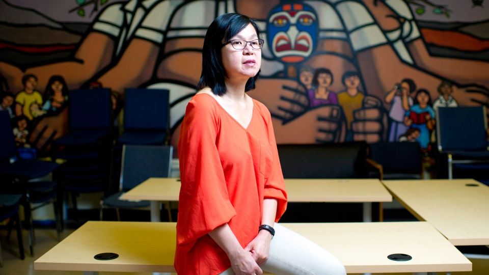 Manager of settlement programs, Khim Tan, poses for a photo in the community room at Mosaic, in Vancouver, B.C. on Monday, May 6, 2013. (Jimmy Jeong / THE CANADIAN PRESS)