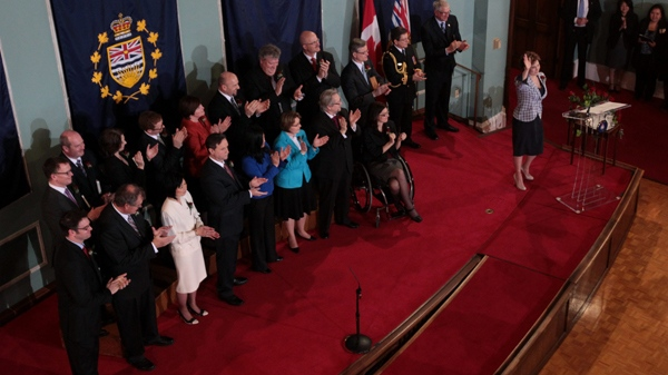 British Columbia Premier Christy Clark, right, waves as her cabinet ministers applaud after she was sworn-in at Government House in Victoria, B.C., on Monday March 14, 2011. (Darryl Dyck / THE CANADIAN PRESS)