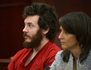 In this March 12, 2013 file photo, James Holmes, left, and defence attorney Tamara Brady appear in district court in Centennial, Colo. for his arraignment. (AP Photo/The Denver Post, RJ Sangosti, Pool, File)