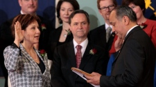 British Columbia Premier Christy Clark, left, is sworn-in by Lt.-Gov. Steven Point at Government House in Victoria, B.C., on Monday March 14, 2011. Clark was elected leader of the BC Liberal Party in February, replacing former premier Gordon Campbell. Looking on at centre is Education Minister George