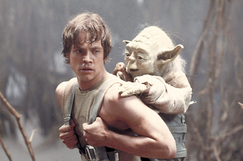 "Mark Hamill as Luke Skywalker and the character Yoda appear in this scene from ""Star Wars Episode V: The Empire Strikes Back"" in this 1980 publicity image originally released by Lucasfilm Ltd. (AP / Lucasfilm Ltd.)"