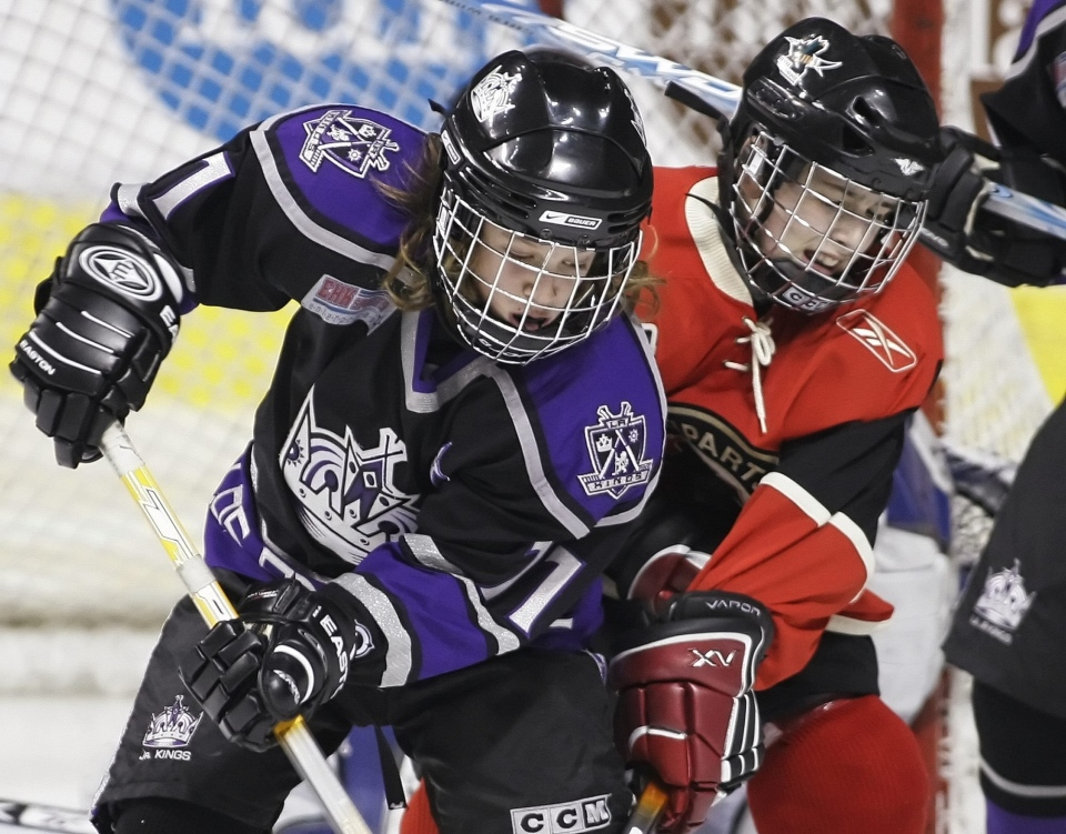 Liam Stewart (11) of Little Los Angeles Kings battle for the puck during second period action against Quebec Remparts Nicolas Lapointe (8) at the Quebec International Peewee Hockey Tournament 2007, Saturday, Feb. 10, 2007. (Clement Allard / THE CANADIAN PRESS)