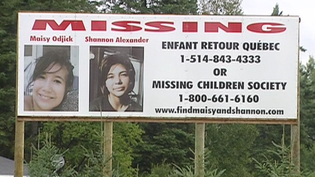A sign near Maniwaki showing the pictures of Maisy Odjick and Shannon Alexander.