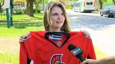 Keila holding her signed Senators jersey