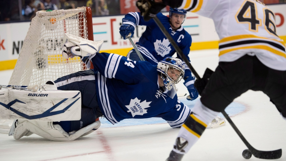 Toronto Maple Leafs goaltender James Reimer makes a diving save on Boston Bruins David Krejci, right, during third period first round NHL playoff action in Toronto on Wednesday May 8, 2013. (Frank Gunn / THE CANADIAN PRESS)