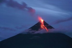 In this July 17, 2006 photo, lava cascades down the slopes of the Mayon volcano in the Philippines. (AP / Bullit Marquez)