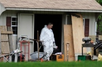 A law enforcement agent searches a shed behind the home of reputed Connecticut mobster Robert Gentile in Manchester, Conn., Thursday, May 10, 2012. (AP / Jessica Hill)