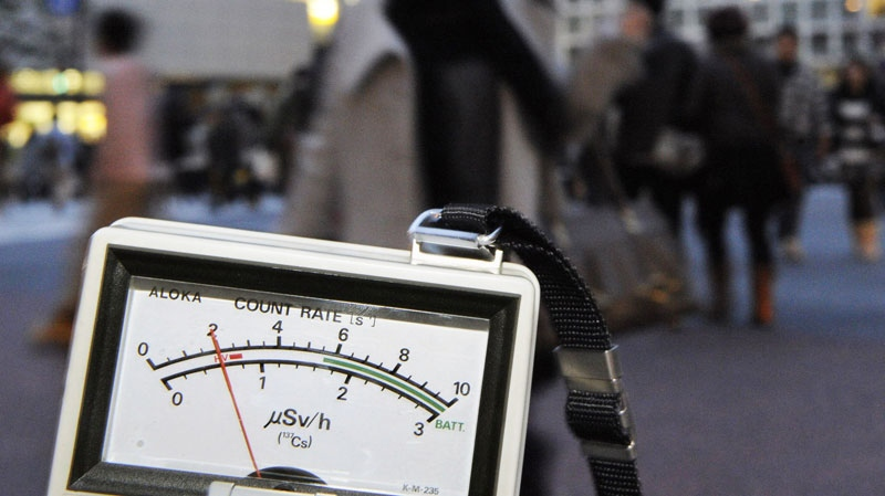 A radiation detector marks 0.6 microsieverts, exceeding normal day data near Shibuya train station in Tokyo on Tuesday, March 15, 2011. (AP / Kyodo News)