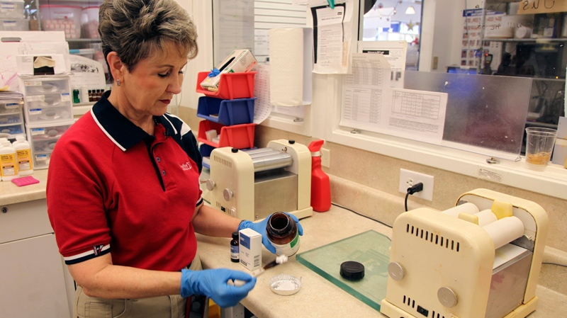 Pharmacist Donna Barsky measures potassium iodide for a prescription at the Texas Star Pharmacy on Monday, March 15, 2011 in Plano, Texas. (AP / Richard Matthews)