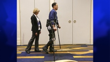 Michael Gore walks with the Indego wearable robot