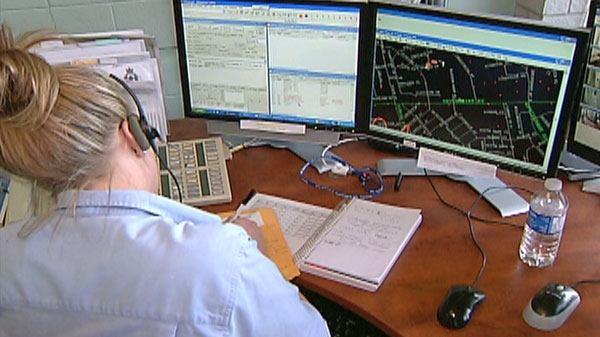 A 911 call taker works at the Com Centre in Woodstock, Ont. on Tuesday, March 15, 2011.