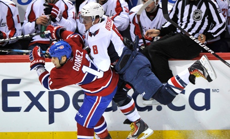 Washington Capitals Alex Ovechkin leans on Montreal Canadiens' Scott Gomez during second period. (March 15, 2011)