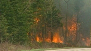 Hundreds of people have left their homes as forest fires continue to burn in New Brunswick.