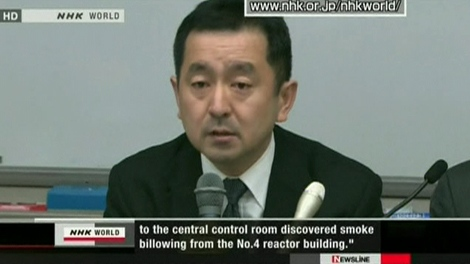A Tokyo Electric Power Company official discusses the fire at the Fukushima Dai-Ichi nuclear power plant's No. 4 reactor unit, Wednesday, March 16, 2011.