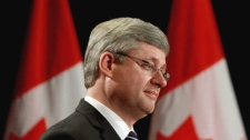 Prime Minister Stephen Harper announces the renewal of the Youth Gang Prevention Fund. in Surrey, B.C., on Tuesday March 15, 2011. THE CANADIAN PRESS/Darryl Dyck
