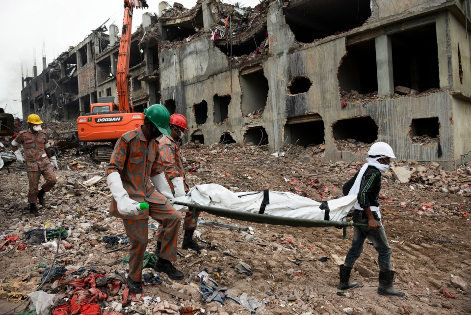 Rescuers carry a body retrieved from the rubble of the eight-story Rana Plaza building that collapsed in Savar, near Dhaka, Thursday, May 9, 2013. (AP / Ismail Ferdous)