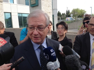 Former Laval mayor Gilles Vaillancourt scrums with reporters outside a courtroom in Laval, Que. on Thursday, May 9, 2013. (Andy Blatchford / THE CANADIAN PRESS)