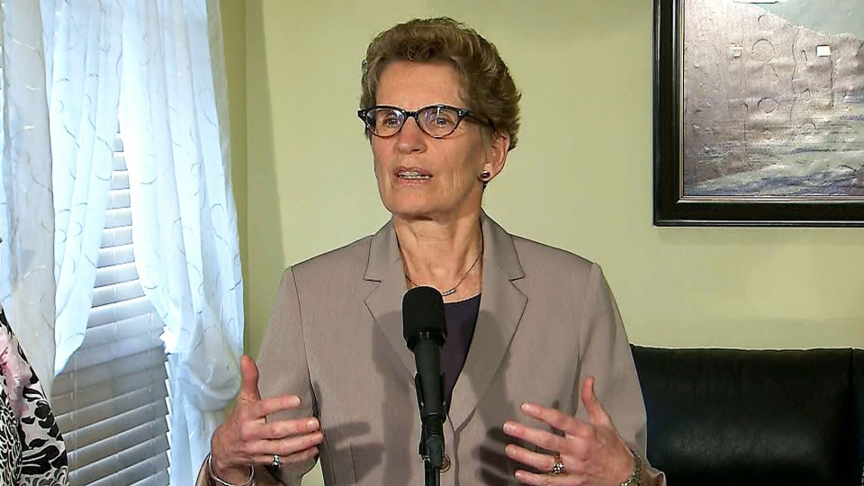 Premier Kathleen Wynne admitted she can't put a date on the pledge to lower auto insurance rates on Thursday, May 9, 2013.