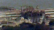 Damage can be seen at the Dai-ichi nuclear power plant after a fire erupted at its No. 4 reactor, Tuesday, March 15, 2011.