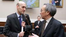 Nuclear Regulatory Commission Chairman Gregory Jaczko, left, talks with Energy Secretary Steven Chu,on Capitol Hill in Washington, Wednesday, March 16, 2011. (AP)