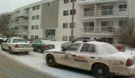A strong police presence at an apartment building in Fort McMurray where an officer was shot, and a male suspect was killed overnight.