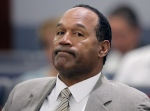This Monday, Sept. 15, 2008, file photo shows O.J. Simpson appearing in court for opening statements on the first day his trial in Las Vegas. Simpson is heading back to the Las Vegas courthouse where he was convicted of leading five men in an armed sports memorabilia heist to ask a judge for a new trial because, he says, the Florida lawyer botched his defense. (AP Photo/Jae C.Hong,File)