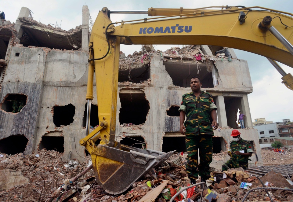 Army personnel work to clear the debris and fallen ceiling of a garment factory building which collapsed in Savar, Bangladesh, on Friday, May 10, 2013. (AP / Ismail Ferdous)