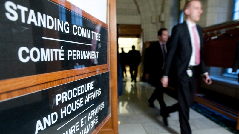 A sign is displayed outside the Standing Committee on Procedure and House Affairs meeting during a break in the Parliamentary contempt hearings on Parliament Hill in Ottawa on Wednesday, March 16, 2011. (Sean Kilpatrick / THE CANADIAN PRESS)