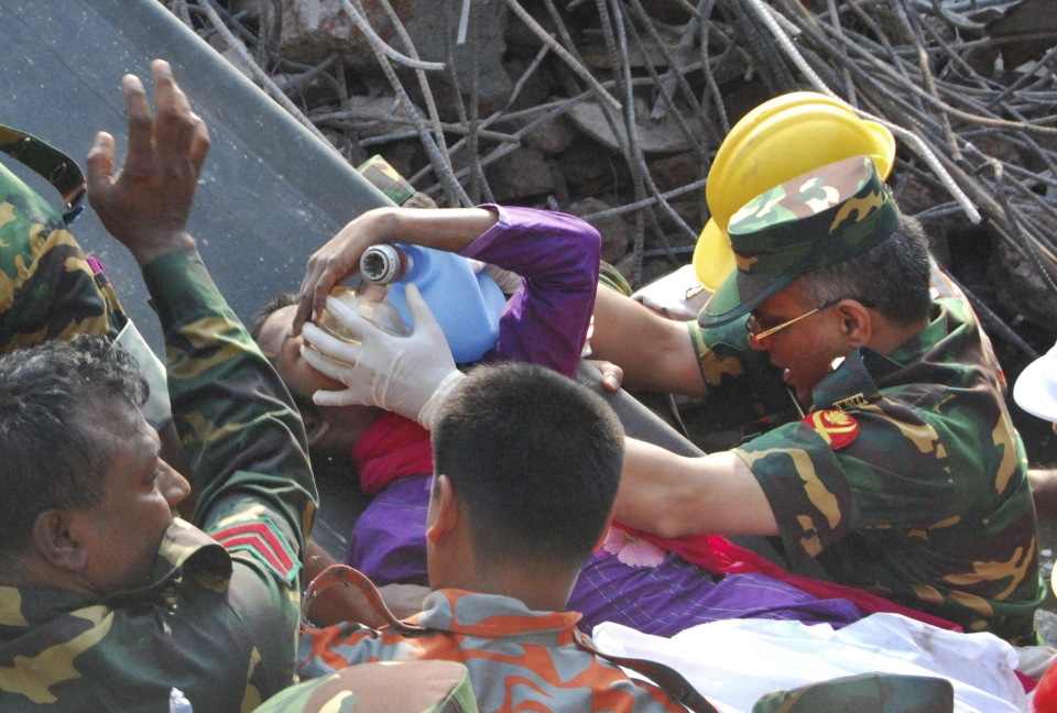 Rescuers carry survivor Reshma Begum after she was pulled out from the rubble of a building that collapsed in Saver, near Dhaka, Bangladesh, Friday, May 10, 2013. (AP / Parvez Ahmad Rony)