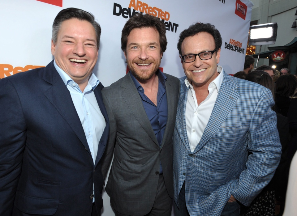 "From left, Ted Sarandos, Jason Bateman, and Mitchell Hurwitz attend the season four premiere of ""Arrested Development"" at the TCL Chinese Theatre on Monday, April 29, 2013 in Los Angeles. (Photo by John Shearer/Invision/AP)"