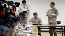 Surrounded by top advisors, Fukushima Gov. Yuhei Sato explains the current difficulties in handling the tens of thousands of evacuees from possibly radiation affected areas around the Fukushima nuclear facilities damaged by last week's major earthquake and following tsunami at the emergency rescue headquarters, Wednesday, March 16, 2011, in Fukushima city, Fukushima prefecture, Japan. (AP)